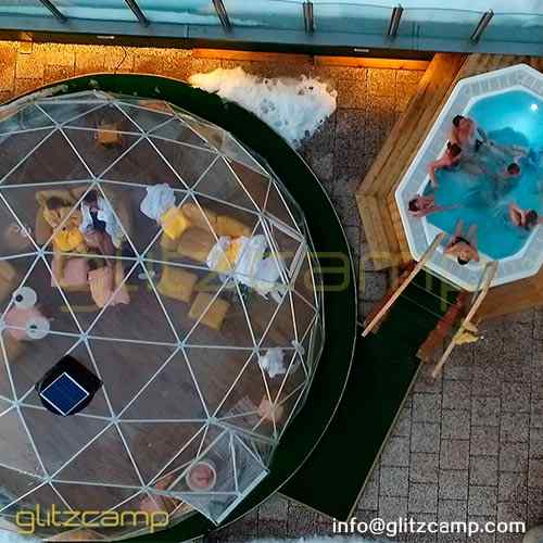 transparent-rooftop-igloo-as-winter-spa-lounge